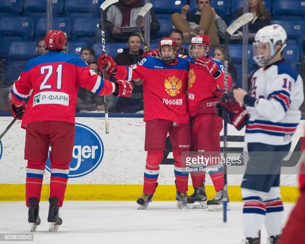 Ivan Morozov of the Russian Nationals celebrates a goal with teammate Alexander Romanov and Kirill Marchenko during the 2018 Under18 Five Nations...