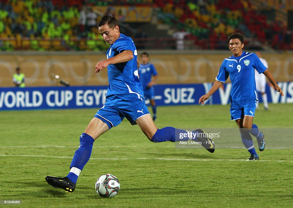 Ivan Nagaev of Uzbekistan scores the opening goal during the FIFA U20 World Cup Group D match between Uzbekistan and England at the Mubarak Stadium on October 2, 2009 in Suez, Egypt.