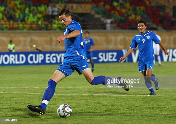 Ivan Nagaev of Uzbekistan scores the opening goal during the FIFA U20 World Cup Group D match between Uzbekistan and England at the Mubarak Stadium...