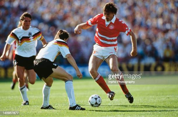 Ivan Nielsen of Denmark looks to take the ball past Mathias Herget of West Germany during the UEFA European Championships 1988 Group 1 match between...