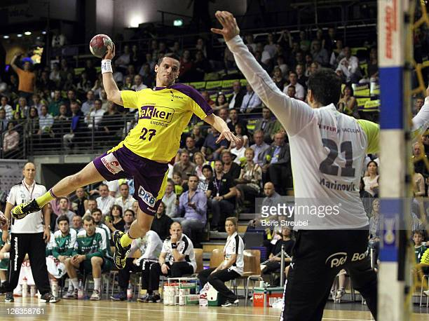 Ivan Nincevic of Berlin and Nikola Marinovic of Wetzlar compete for the ball during the Toyota Handball Bundesliga match between Fuechse Berlin and...