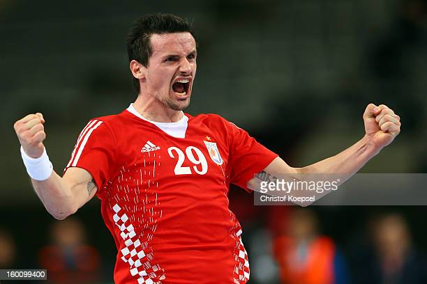 Ivan Nincevic of Croatia celebrates a goal during the Men's Handball World Championship 2013 third place match between Slovenia and Croatia at Palau...