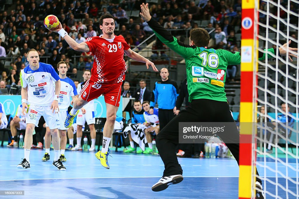 Ivan Nincevic of Croatia scores a goal against Primoz Prost of Slovenia during the Men's Handball World Championship 2013 third place match between Slovenia and Croatia at Palau Sant Jordi on January 26, 2013 in Barcelona, Spain.