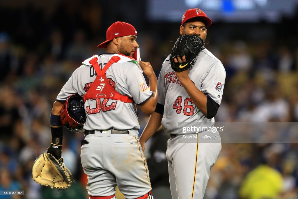 Ivan Nova #46 of the Pittsburgh Pirates talks with catcher Elias Diaz #32 on the mound during the fourth inning of a game against the Los Angeles Dodgers at Dodger Stadium on July 3, 2018 in Los Angeles, California.