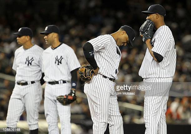 Ivan Nova Robinson CanoDerek Jeter and Alex Rodriguez of the New York Yankees look on against the Detroit Tigers during Game One of the American...