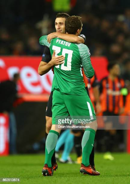 Ivan Ordets of Shakhtar Donetsk and Andriy Pyatov of Shakhtar Donetsk embrace after the UEFA Champions League group F match between Feyenoord and...