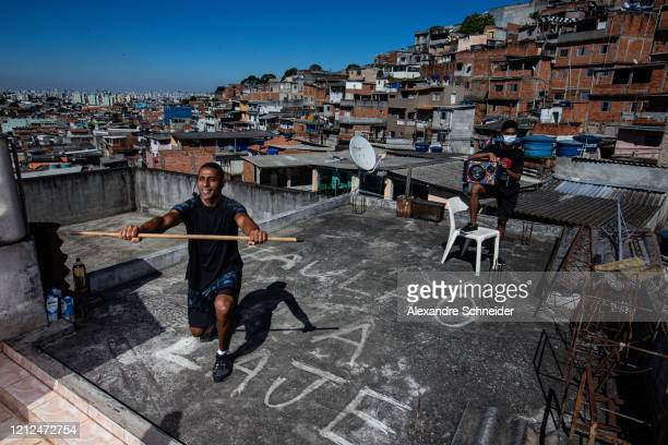 Ivan Pereira do Nascimento 39 years old conducts training sessions from the roof of his house to residents of Brasilandia amidst the coronavirus...