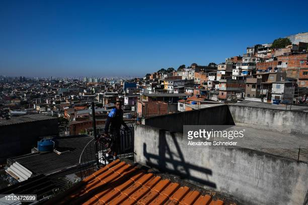 Ivan Pereira do Nascimento 39 years old goes up to the roof of his house to conduct a training session to residents of Brasilandia amidst the...
