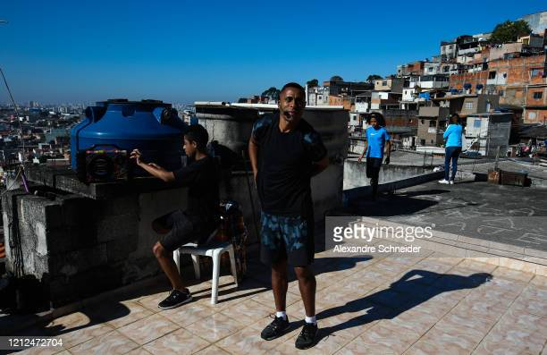 Ivan Pereira do Nascimento 39 years old prepares to conduct a training session from the roof of his house to residents of Brasilandia amidst the...
