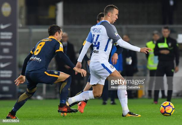 Ivan Periic of FC Internazionale competes for the ball whit Marco Fossati of Hellas Verona during the Serie A match between Hellas Verona FC and FC...
