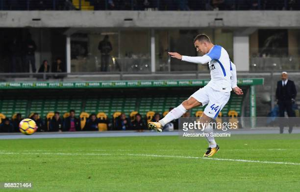 Ivan Periic of FC Internazionale scores his team second goal during the Serie A match between Hellas Verona FC and FC Internazionale at Stadio...