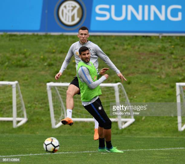 Ivan Perisic and Lisandro Lopez of FC Internazionale compete for the ball during the FC Internazionale training session at the club's training ground...