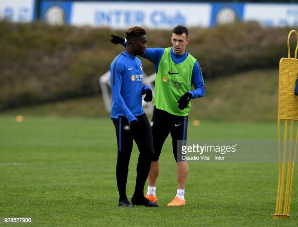 Ivan Perisic and Yann Karamoh of FC Internazionale chat during the FC Internazionale training session at the club's training ground Suning Training...