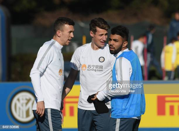 Ivan Perisic Andrea Pinamonti and Gabriel Barbosa Almeida of FC Internazionale chat during a FC Internazionale training session at Suning Training...