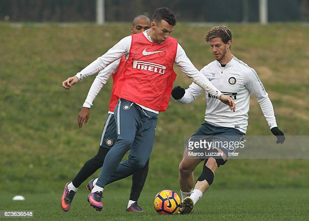 Ivan Perisic is challenged by Christian Ansaldi during the FC Internazionale training session at the club's training ground La Pinetina on November...