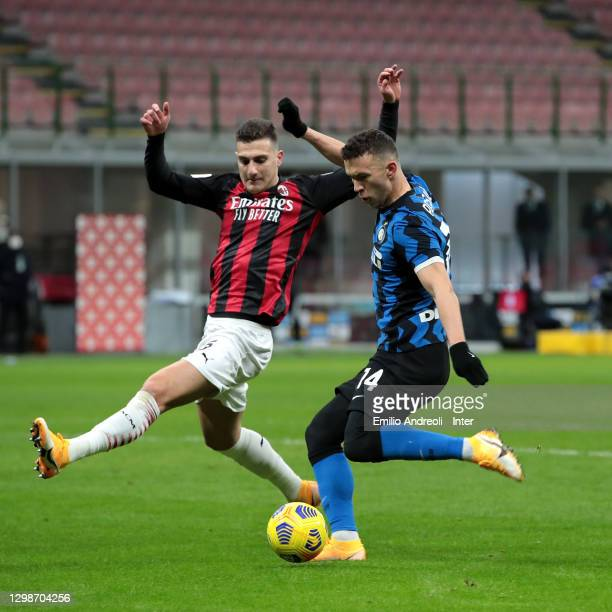 Ivan Perisic is challenged by Diogo Dalot of AC Milan during the Coppa Italia match between FC Internazionale and AC Milan at Stadio Giuseppe Meazza...