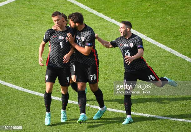 Ivan Perisic of Croatia celebrates with Bruno Petkovic and Luka Ivanusec after scoring their side's first goal during the UEFA Euro 2020 Championship...