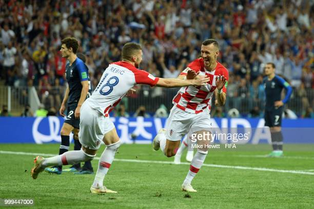Ivan Perisic of Croatia celebrates with teammate Ante Rebic after scoring his team's first goal during the 2018 FIFA World Cup Final between France...