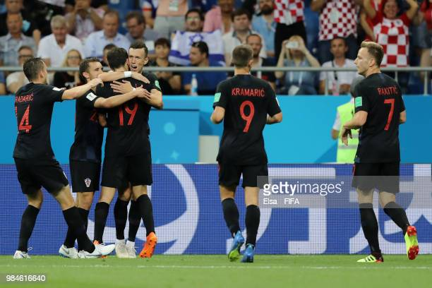 Ivan Perisic of Croatia celebrates with teammates after scoring his team's second goal during the 2018 FIFA World Cup Russia group D match between...