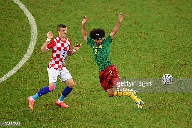 Ivan Perisic of Croatia competes for the ball wtih Benoit AssouEkotto of Cameroon during the 2014 FIFA World Cup Brazil Group A match between...