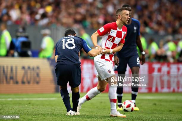 Ivan Perisic of Croatia helps Nabil Fekir of France to his feet during the 2018 FIFA World Cup Russia Final between France and Croatia at Luzhniki...