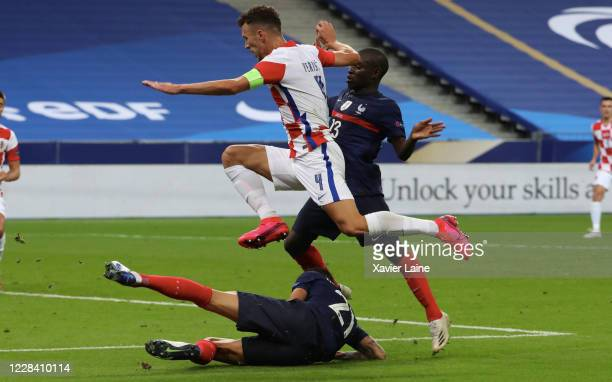 Ivan Perisic of Croatia in action with Ngolo Kante of Crotia during the UEFA Nations League group stage match between France and Croatia at Stade de...