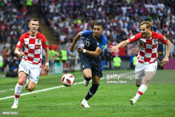 Ivan Perisic of Croatia, Kylian Mbappe of France and Ivan Strinic of Croatia during the World Cup Final match between France and Croatia at Luzhniki...