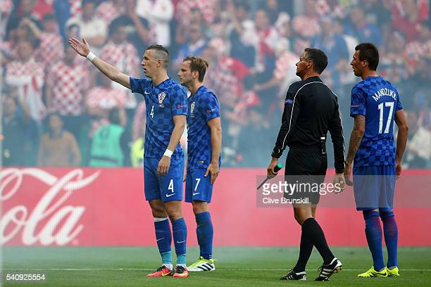 Ivan Perisic of Croatia reacts to supporters who have thrown a flare onto the pitch during the UEFA EURO 2016 Group D match between Czech Republic...