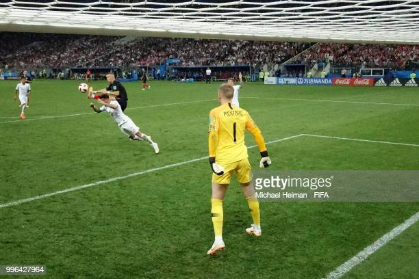 Ivan Perisic of Croatia scores his team's first goal past Jordan Pickford of England during the 2018 FIFA World Cup Russia Semi Final match between...