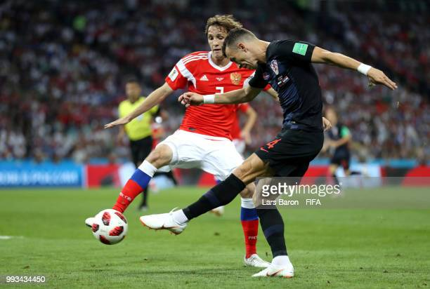 Ivan Perisic of Croatia shoots past Mario Fernandes of Russia during the 2018 FIFA World Cup Russia Quarter Final match between Russia and Croatia at...