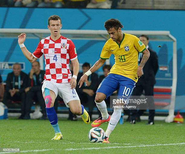 Ivan Perisic of Croatia struggles with his competitor Neymar of Brazil during the 2014 FIFA World Cup Brazil Group A match between Brazil and Croatia...