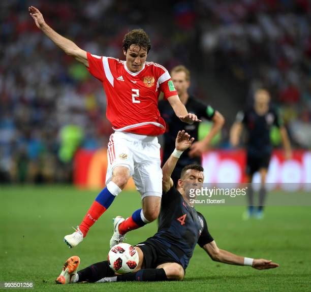 Ivan Perisic of Croatia tackles Mario Fernandes of Russia during the 2018 FIFA World Cup Russia Quarter Final match between Russia and Croatia at...