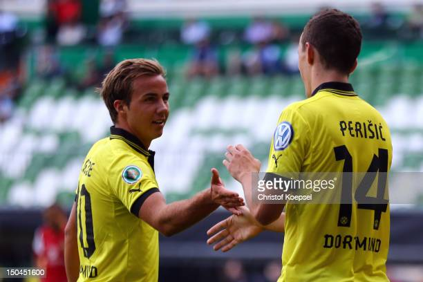 Ivan Perisic of Dortmund celebrates the third goal with Mario Goetze of Dortmund during the first round DFB Cup match between FC Oberneuland and...