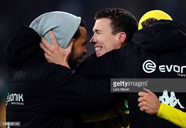 Ivan Perisic of Dortmund celebrates with Patrick Owomoyela after scoring his teams winning goal during the DFB Cup third round match between Fortuna...