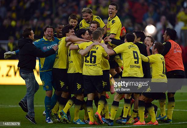 Ivan Perisic of Dortmund celebrates with team mates after winning the Bundesliga match between Borussia Dortmund and Borussia Moenchengladbach at...