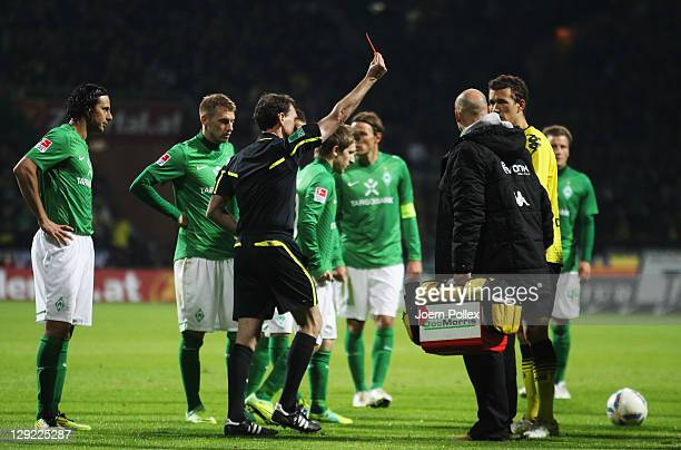 Ivan Perisic of Dortmund gets the red card from Referee Florian Meyer during the Bundesliga match between Werder Bremen and Borussia Dortmund at...