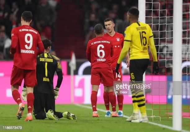 Ivan Perisic of FC Bayern Muenchen celebrates his goal with teammate Thiago and Robert Lewandowski as goalkeeper Roman Buerki and Manuel Akanji of...