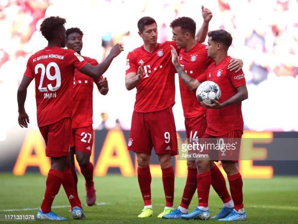 Ivan Perisic of FC Bayern Munich celebrates with team mates David Alaba Robert Lewandowski Philippe Coutinho and Kingsley Coman of FC Bayern Munich...