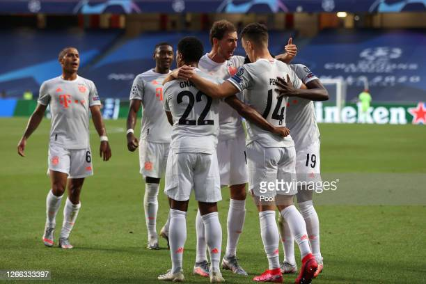 Ivan Perisic of FC Bayern Munich celebrates with teammates after scoring his team's second goal during the UEFA Champions League Quarter Final match...