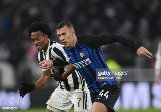 Ivan Perisic of FC Internazionale and Juan Cuadrado of Juventus FC compete for the ball during the Serie A match between Juventus and FC...