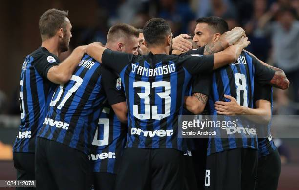 Ivan Perisic of FC Internazionale celebrates with his teammates after scoring the opening goal during the serie A match between FC Internazionale and...