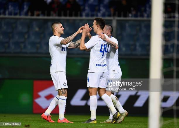Ivan Perisic of FC Internazionale celebrates with Mauro Icardi after scoring the third goal during the Serie A match between Genoa CFC and FC...