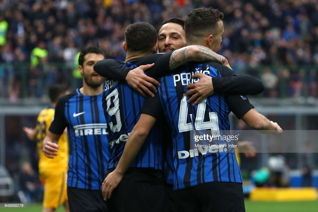 Ivan Perisic of FC Internazionale celebrates with team-mates after scoring the opening goal during the serie A match between FC Internazionale and Hellas Verona FC at Stadio Giuseppe Meazza on March 31, 2018 in Milan, Italy.