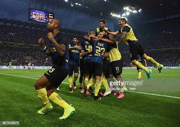 Ivan Perisic of FC Internazionale celebrates with teammates and Felipe Melo after scoring the goal during the Serie A match between FC Internazionale...