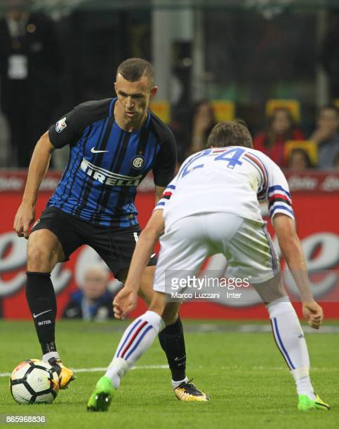 Ivan Perisic of FC Internazionale competes for the ball with Bartosz Bereszynski of UC Sampdoria during the Serie A match between FC Internazionale...