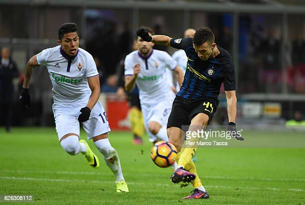 Ivan Perisic of FC Internazionale competes for the ball with Carlos Salcedo of ACF Fiorentina during the Serie A match between FC Internazionale and...