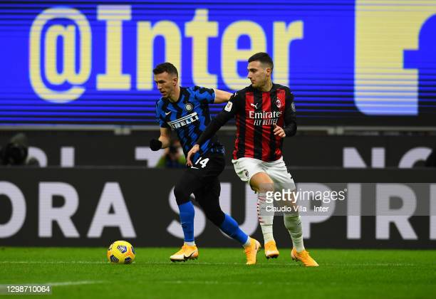 Ivan Perisic of FC Internazionale competes for the ball with Diogo Dalot of AC Milan during the Coppa Italia match between FC Internazionale and AC...