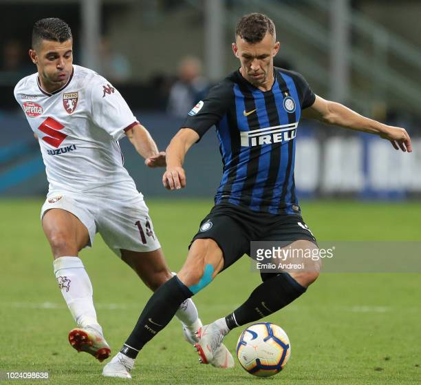 Ivan Perisic of FC Internazionale competes for the ball with Iago Falque of Torino FC during the serie A match between FC Internazionale and Torino...