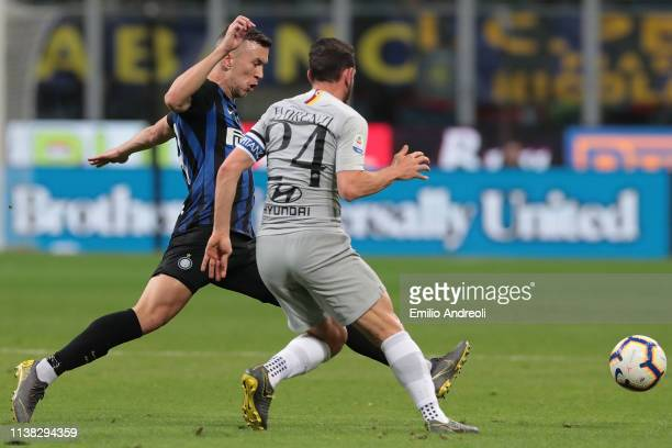 Ivan Perisic of FC Internazionale is challenged by Alessandro Florenzi of AS Roma during the Serie A match between FC Internazionale and AS Roma at...