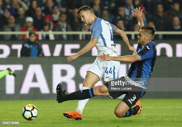 Ivan Perisic of FC Internazionale is challenged by Rafael Toloi of Atalanta BC during the serie A match between Atalanta BC and FC Internazionale at...